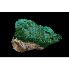 Rough green malachite formed on cream-coloured stone